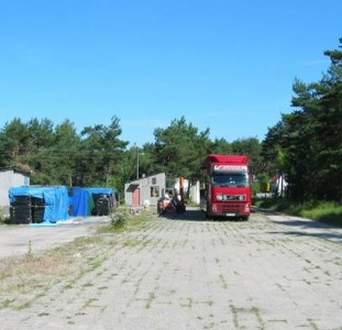 Территория 8400 m2 с постройками продам в Польше